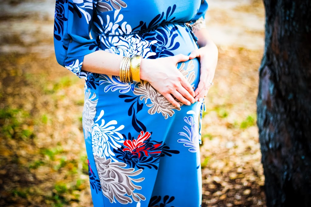 pregnant belly in blue dress