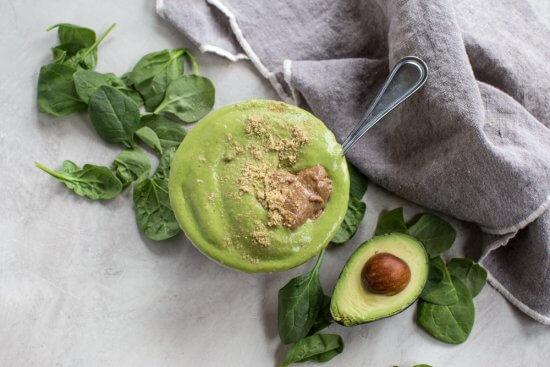 dairy free and vegan energy bowl with spinach, bananas, mango, and avocado