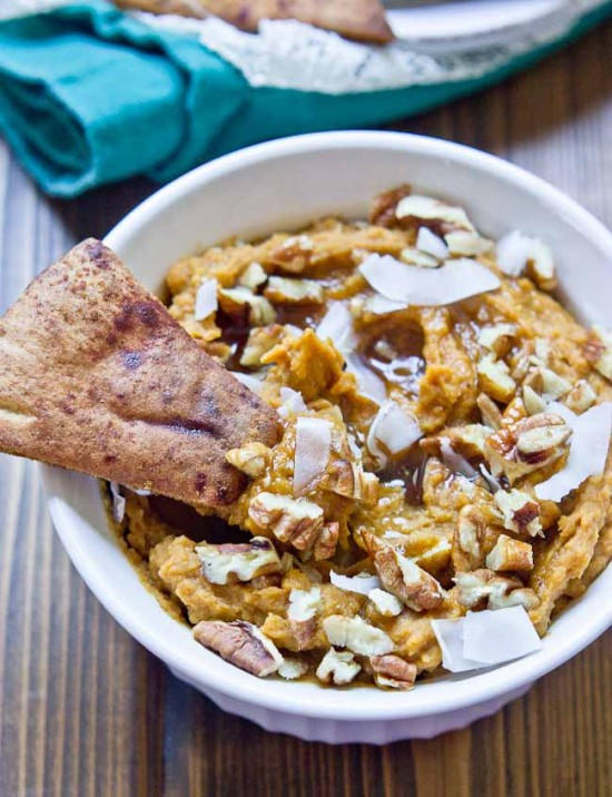 This Sweet Potato Pie Dessert Hummus will rock your socks. It tastes just like mama's sweet potato pie but with all the healthy ingredients. Eat this hummus anytime— breakfast, lunch, dinner, dessert. Serve with apples and cinnamon pita chips at your fall party!
