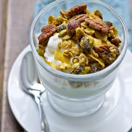 This Maple Pecan & Ginger Granola is savory and sweet with the perfect blend of fall flavors--maple, pecans, & cranberries. It's yummy topped on Greek yogurt and oatmeal!