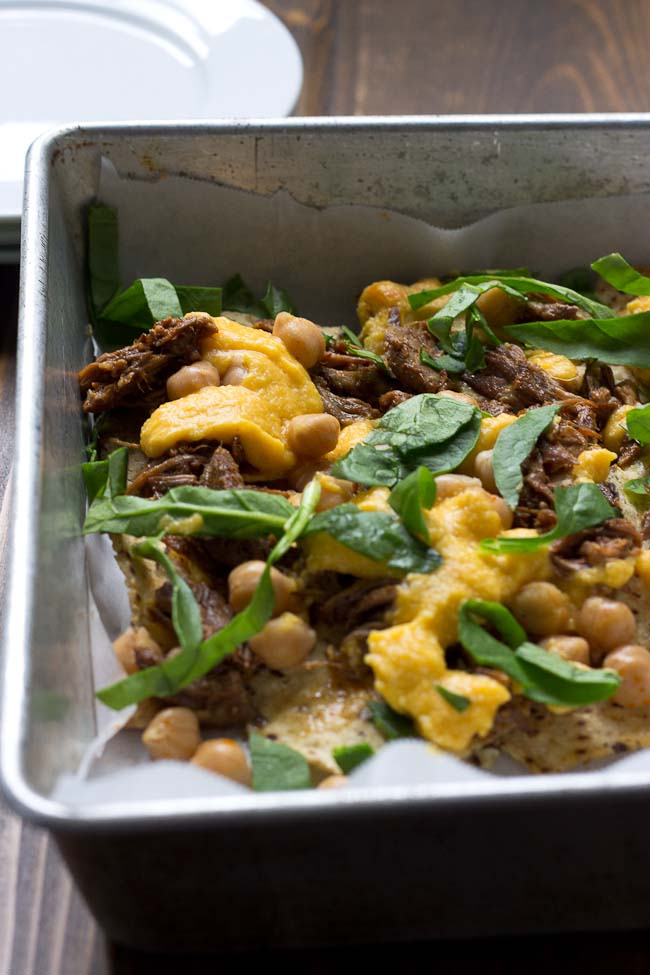 Not your mama's nachos but these Slow Cooker Steak Nachos with Spicy Butternut Squash Queso are as flavor filled as it gets! Butternut squash makes the queso creamy with half the cheese to save fat and calories. Oh and the steak is crazy tender, perfectly seasoned and made right in the slow cooker!