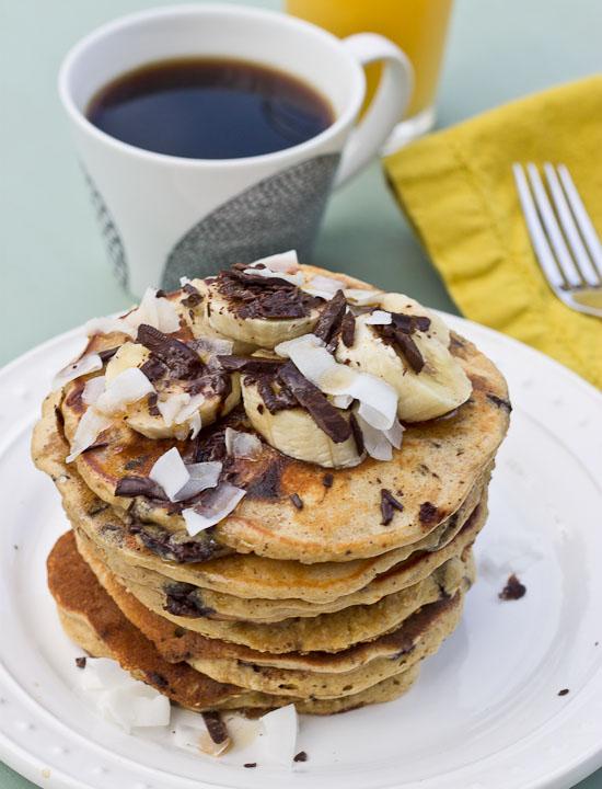 Shaved dark chocolate, smashed banana, coconut flakes, and coconut Greek yogurt = Funky Monkey Pancakes. You will melt.