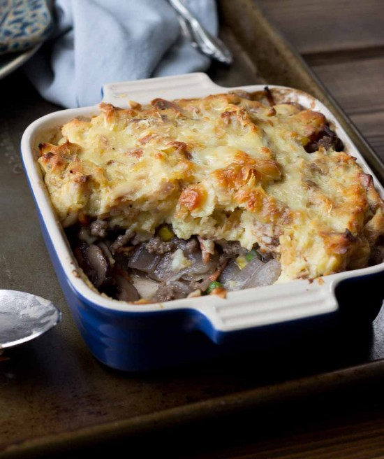 This Healthy Shepard's Pie for Two is the ultimate comfort meal. It's meaty and veggie-fied topped with insanely creamy mashed potatoes. You're welcome.