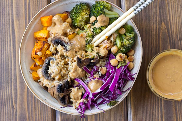Abundance Bowls with Almond Butter-Lemon Dressing. Roasted veggies topped with the creamiest lemony almond butter dressing! This vegan abundance bowl will make you feel ahhhhhmazing from the inside out!