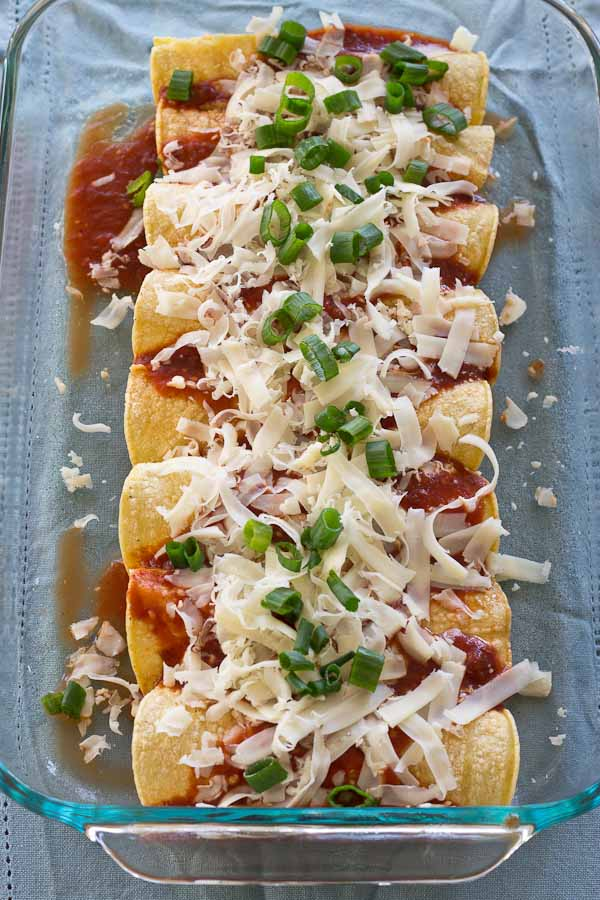 These Healthy Chicken Enchiladas are made with homemade enchilada sauce that you can feel good about. This simple weeknight meal will quickly become a family favorite. Serve with a side of beans and shredded lettuce.