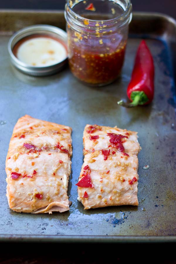 Sweet Chili Thai Salmon is a spiced up version of your traditional baked salmon. Sweet, hot and perfectly baked salmon out of the oven in 15 minutes flat.