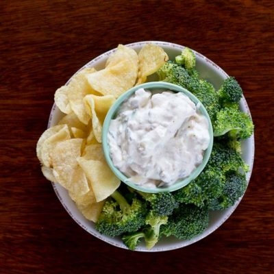 This Healthy French Onion Dip made with Greek yogurt and shredded zucchini makes a great party appetizer or snack. You're guests will never know it's healthy.