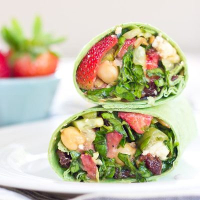 This Strawberry Salad Wrap is bursting with all the goodness of the Spring season. Sweet strawberries, crisp cucumbers and romaine lettuce tossed with a zesty balsamic vinaigrette and folded into a spinach wrap. Can't get enough.