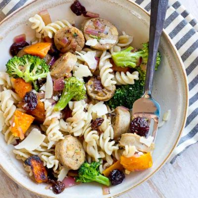 This Chicken Pasta with Butternut Squash, Caramelized Onions and Tart Cherries is perfect for fueling muscles post workout. The balance of protein, carbs, and anti-inflammatory foods in this recipe is one to keep on hand after a tough sweat session or to fuel up for a race day. | @KristinaLaRueRD