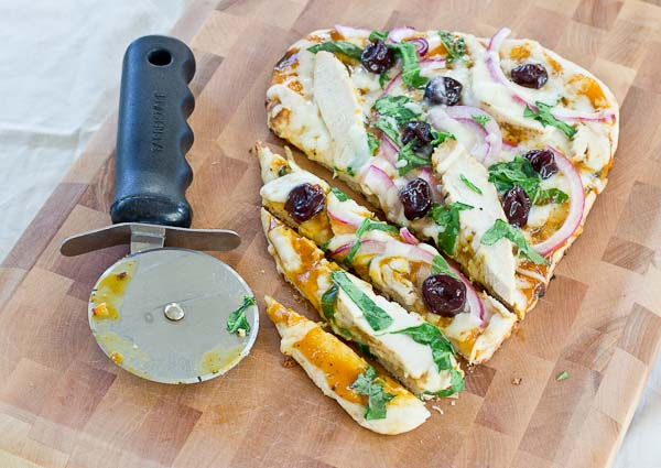 Fire up the grill for this BBQ Chicken Naan Pizza with Tart Cherries—it's perfect for a summer gathering and comes together in just minutes!