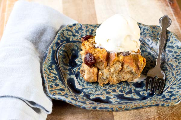 This Pumpkin Bread Pudding with Tart Cherries will warm up your home and fall spirit. Serve a warmed slice a la mode with a scoop of vanilla ice cream for extra decadence. You can thank me later. | @KristinaLaRueRD | loveandzest.com