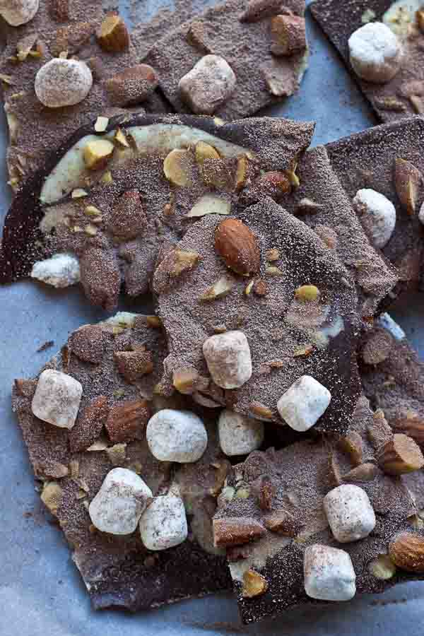 Hot Cocoa Almond Bark... dark chocolate with white chocolate swirl, marshmallows, almonds, and a dusting of hot cocoa.... a super easy recipe to throw together for a holiday party and it's oh so festive!