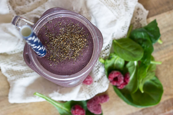 Get this Superfood Smoothie crammed packed with good for you stuff like chia seeds, ground flax, loads of berries, almond butter, and spinach. I love the purple color of this green smoothie! You'd never know there were greens hidden in there!