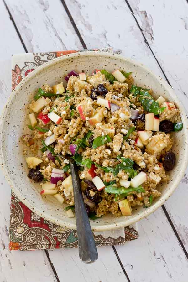 Make a batch of this Cinnamon Apple Quinoa Salad to eat during the week for a quick and healthy lunch. This grain salad made with quinoa, apples, tart cherries, spinach and feta makes you feel super healthy with every bite. Serve on a bed of lettuce for an even bigger nutrition boost.