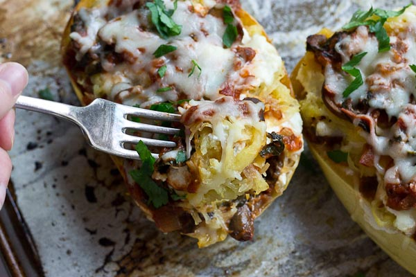 These Vegetarian Lasagna Spaghetti Squash Boats will rock your world. It's super filling and each boat is packed with several cups of mushrooms, onions, and spinach! Talk about veggie-fied. You're going to love this lower carb and meatless take on lasagna that will satisfy that pasta craving.