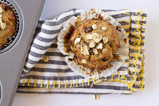 These Almond Butter Banana Oat Muffins are moist, satisfying, and have an delicious almond butter banana flavor. There is just enough chocolate in every bite to satisfy a sweet tooth. Flourless and gluten free.