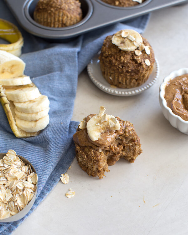 These Banana Oatmeal Muffins are moist, healthy and oil free applesauce muffins with a delicious cinnamon banana flavor. Easy gluten free muffins made with oat flour!