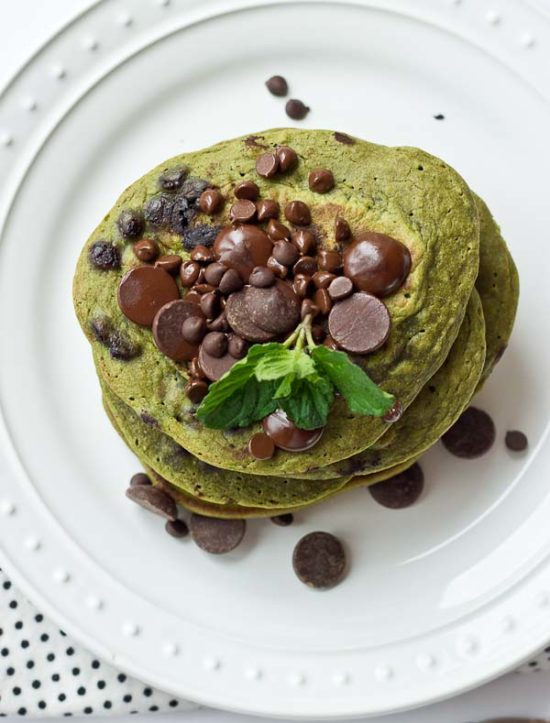 Start your morning with these Mint Chocolate Chip Blender Pancakes! These taste like Mint Chocolate Chip ice cream but in pancake form. Get your green pancake on just in time for St Patty's Day! Whole wheat, dye and coloring free, dark chocolate, and a hidden source of veggies for breakfast.