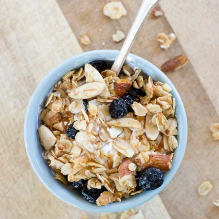 Blueberry Muffin Granola tastes like a warm coffee shop-like blueberry muffin, with a healthy twist of course; no refined sugar or flour here. The best part is that comforting smell of homemade blueberry muffins fills the house while the granola bakes!
