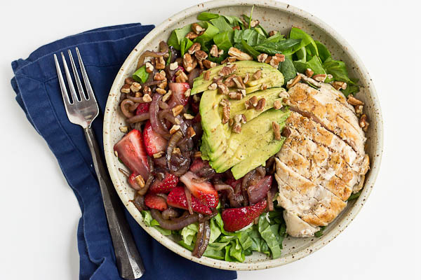 This Strawberry Balsamic Grilled Chicken Salad is light, crisp and perfect for summertime eating. The warm chicken and balsamic strawberries and onions add so much flavor to this salad. You're' going to love it!