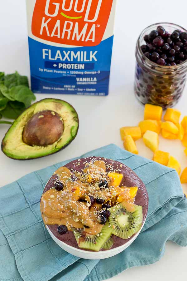 With summer quickly approaching, this superfood smoothie bowl will keep you cool and fueled on the sunniest days. Wild blueberries, spinach, avocado, and flaxmilk combine to form a creamy, antioxidant-packed bowl that is vegan and gluten-free! Slices of fresh kiwi and a drizzle of almond butter make this smoothie bowl practically irresistible.