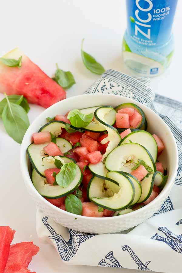 This Watermelon Cucumber Salad is all about fresh summer produce and just 5 ingredients. Watermelon, cucumber, basil and coconut water will hydrate and make you feel refreshed from the inside out.