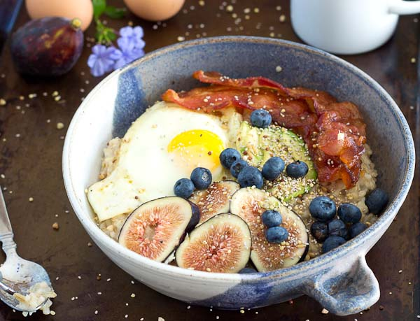 It's time to shake up that sweet oatmeal bowl and make it savory with bacon, eggs, and avocado! This Savory Oatmeal Bowl is high protein and will keep you energized all morning long.