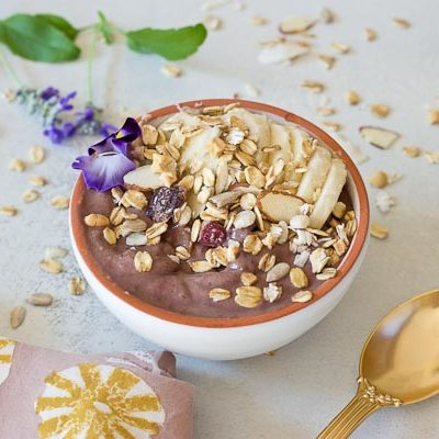 This Banana Peanut Butter Breakfast Bowl is seriously the best smoothie bowl ever. It's naturally sweetened with medjool dates, bananas and power packed with antioxidants from unsweetened acai. The creaminess factor was upped with plain kefir and peanut butter and topped with bananas (naturally) and gluten free muesli for irresistible crunch in every bite.