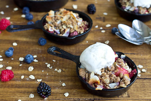 Soak up the last of summer with this Skillet Mixed Berry Oatmeal Crisp. Blueberries, raspberries, strawberries, and blackberries nestled under a warm oatmeal crisp topping and a scoop of Breyers® Natural Vanilla ice cream. So good!