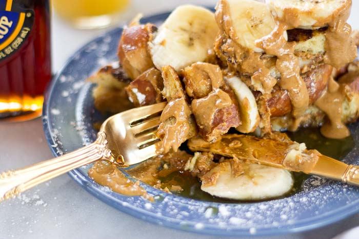 This Creamy Peanut Butter and Banana Stuffed French toast is dabomb dot com. Like I'm so pumped about this flavor combo. Bring on the creamy PB and bananas please!