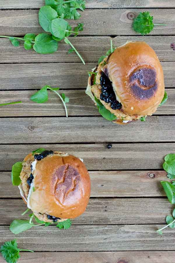 These Salmon Sliders with Blueberry Compote are quite possibly the best way to eat salmon at home! Convenience, price, and deliciousness! Warm salmon cakes, wild blueberries compote, maple goat cheese spread, toasted buttery buns = BEST FOOD EVER.