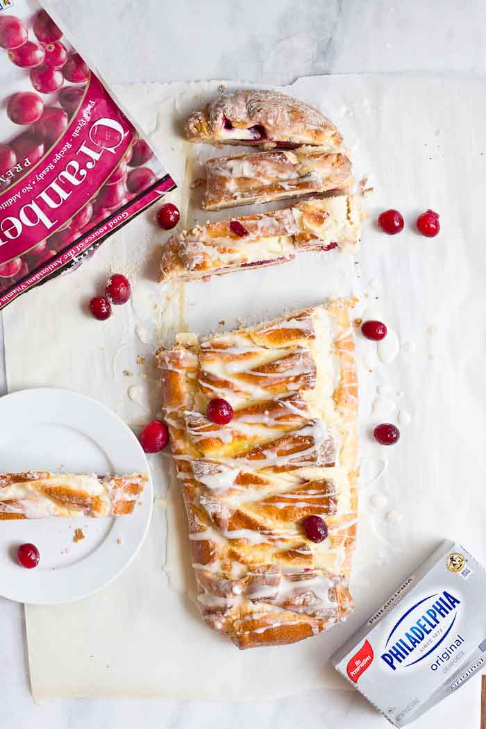 The flavors in this Cranberry Cream Cheese Braid are spot on and bursting with holiday freshness. Cranberries, cream cheese, and pillowy pastry dough...I'm like YIPPEEE! It's the most wonderful time of the year.