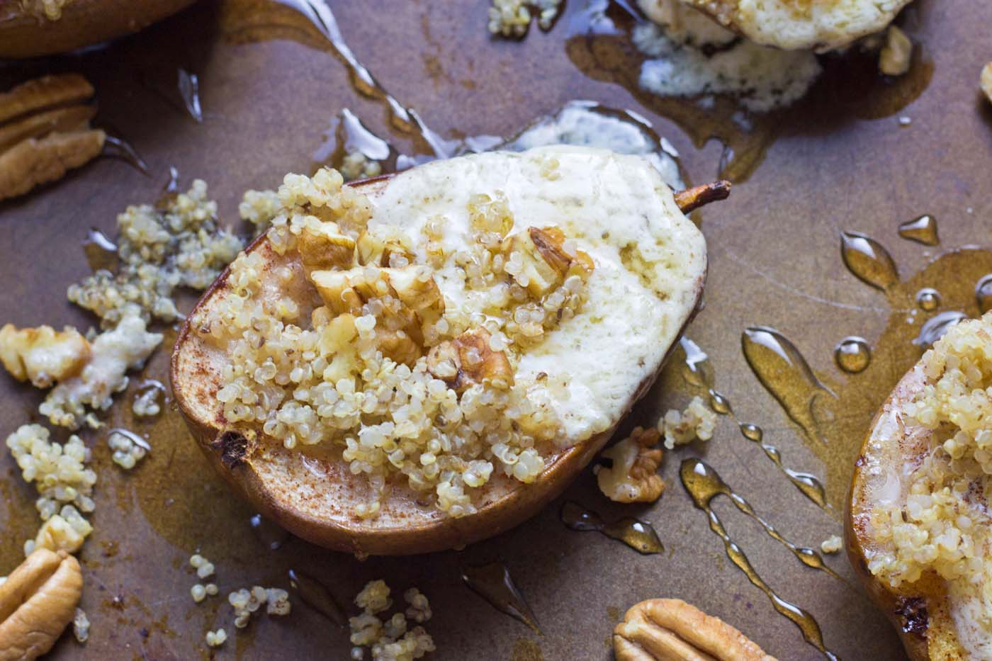 Roasted Quinoa Stuffed Pears are exactly what I want to eat on a cool morning this fall. These pears are stuffed with mascarpone cheese, quinoa, and pecans. So yum!