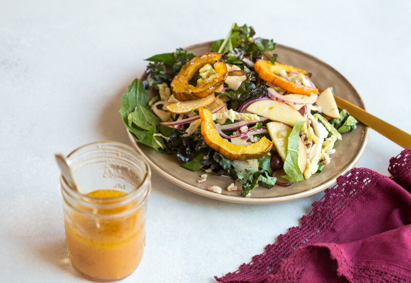 This Winter Greens Salad with Citrus Vinaigrette tho. It's exactly what should be on your holiday table--- warm acorn squash, apple slaw, winter greens, hearty grains and a tangy citrus vinaigrette! Add grilled chicken or garbanzo beans to make this salad a meal, or serve as a salad in your holiday spread.