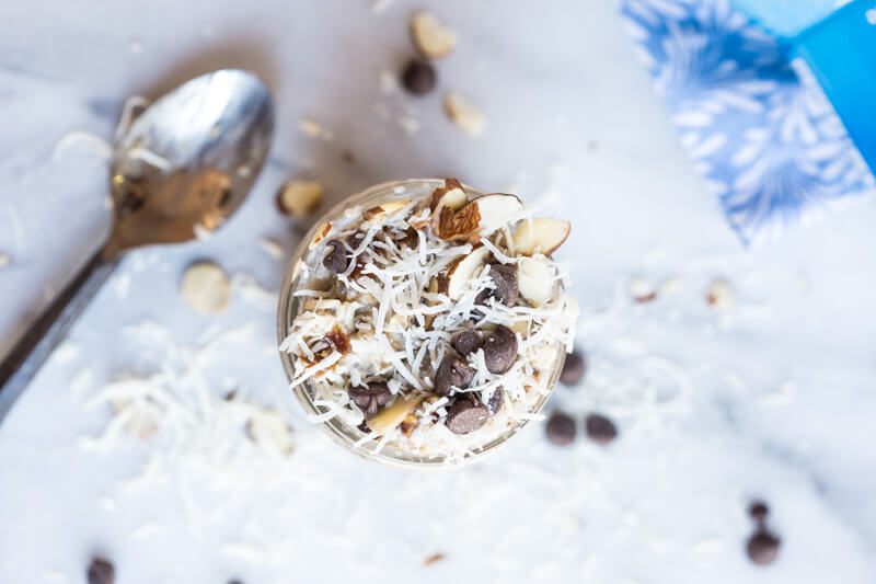 Almond Joy Overnight Oats made with coconut water.... say what??!! Yep, healthy dessert for breakfast... NO ADDED SUGAR and dairy free (well, minus the chocolate on top...but gimmeee all dat chocolate!)