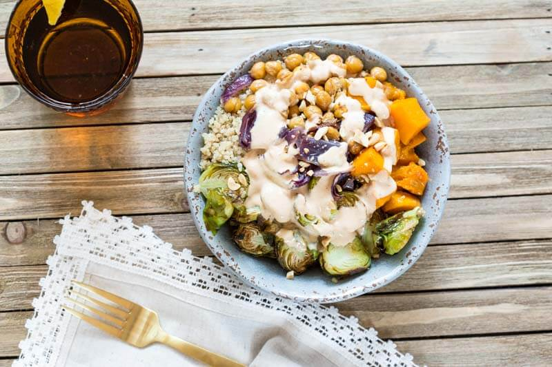 This Vegetarian Nourish Bowl is power packed with nutritious and detoxifying foods that will nourish your body from the inside out! Roasted butternut squash, Brussels sprouts, garbanzo beans and quinoa drizzled with a lemon peanut sauce....YUMMA!