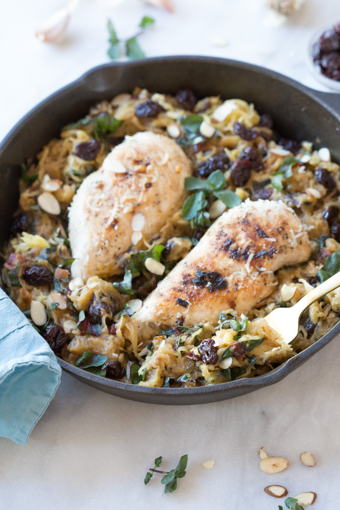 All the things you need on a busy weeknight... garlic butter chicken spaghetti squash skillet with kale, tart cherries, and cheese baked in the cast iron.