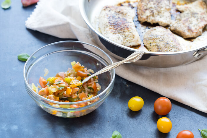 Italian herbed browned turkey breast served bruschetta-style sans bread with fresh basil, heirloom tomatoes, and a drizzle of tangy balsamic. Skillet Italian Herb Bruschetta Turkey is easy to cook and has so much flavor!