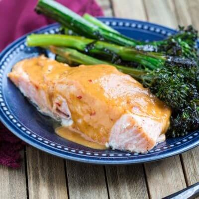 Easy Baked Salmon with Spicy Peanut Butter Glaze-- a zesty, citrusy, peanut butter glaze that takes salmon to the next level.