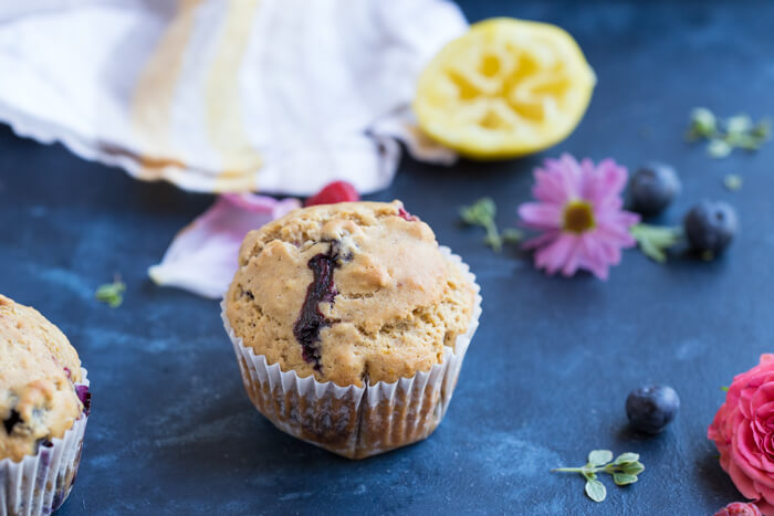 These Lemon Berry Breakfast Muffins are made with whole wheat flour, coconut oil, lemons, blueberries and raspberries and they make a wholesome snack or breakfast!