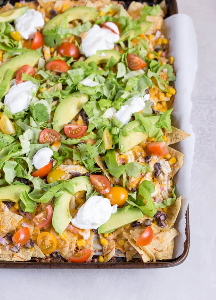 Love all the foods with tortilla chips and avocado... so naturally, Sheet Pan Chicken Nachos is a family favorite. It's one of those weeknight meals that we keep on rotation.