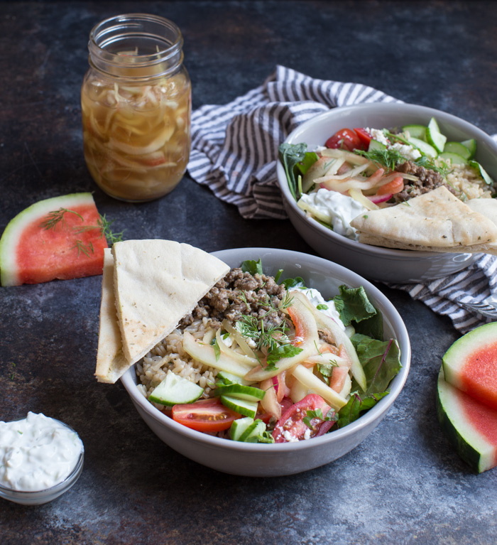 Gyro Salad Bowls with Pickled Watermelon Rind are what you make when you're living life to the fullest. Instead of tossing your watermelon rind, pickle it and make gyro salad bowls!