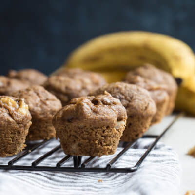 These Healthy Banana Bread Muffins with Walnuts are made with less sugar, whole wheat flour, and yes, that extra banana! We even subbed in maple syrup instead of white sugar into this recipe.