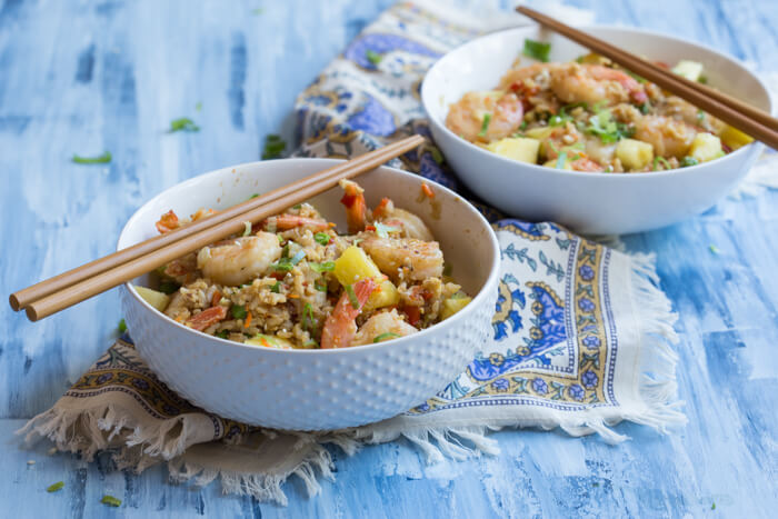 """This Shrimp Cauliflower Fried Rice is ready in just 25 minutes! This is the perfect dish for a quick, need it in a hurry Monday through Friday meal or just as a healthier alternative to the standard cozy """"take out and a movie"""" meal."""