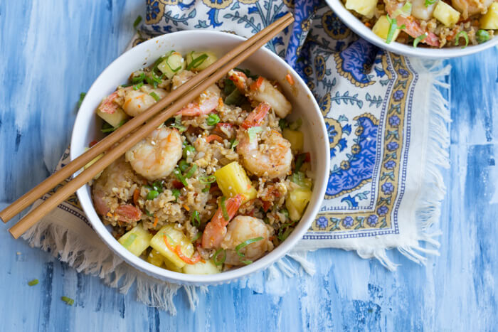 "This Shrimp Cauliflower Fried Rice is ready in just 25 minutes! This is the perfect dish for a quick, need it in a hurry Monday through Friday meal or just as a healthier alternative to the standard cozy ""take out and a movie"" meal."