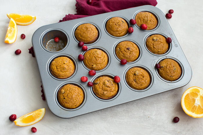 "These gluten free Pumpkin Cranberry Orange Muffins are what I like to call ""Morning Glory"". They are an early morning, warm cup of chai tea with a splash of eggnog, and a cozy-blanket-snuggle-on-the-sofa type of muffins."