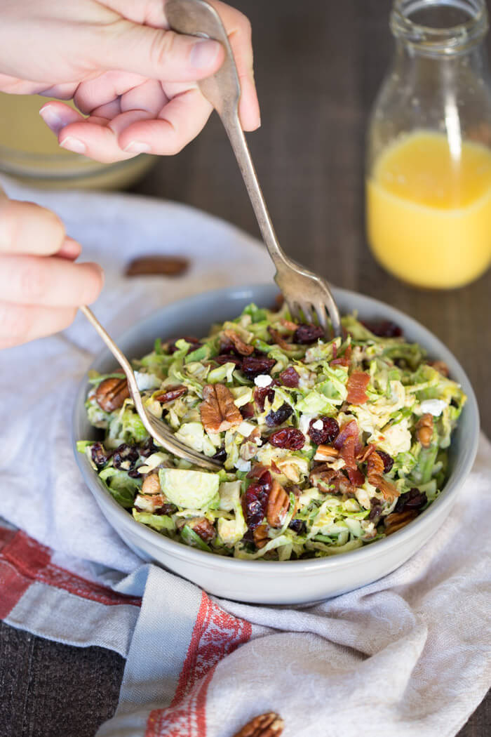 Shaved Brussels Sprout Salad with Citrus Bacon Vinaigrette... the best hearty and nourishing winter side salad to add to your holiday menu.