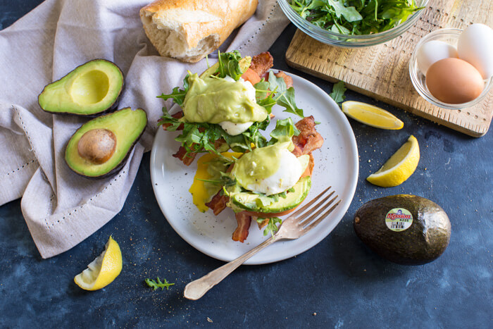 Eggs Benedict BLT with Avocado Hollandaise, a hearty comforting breakfast recipe that's packed with nutrition thanks to avocados.