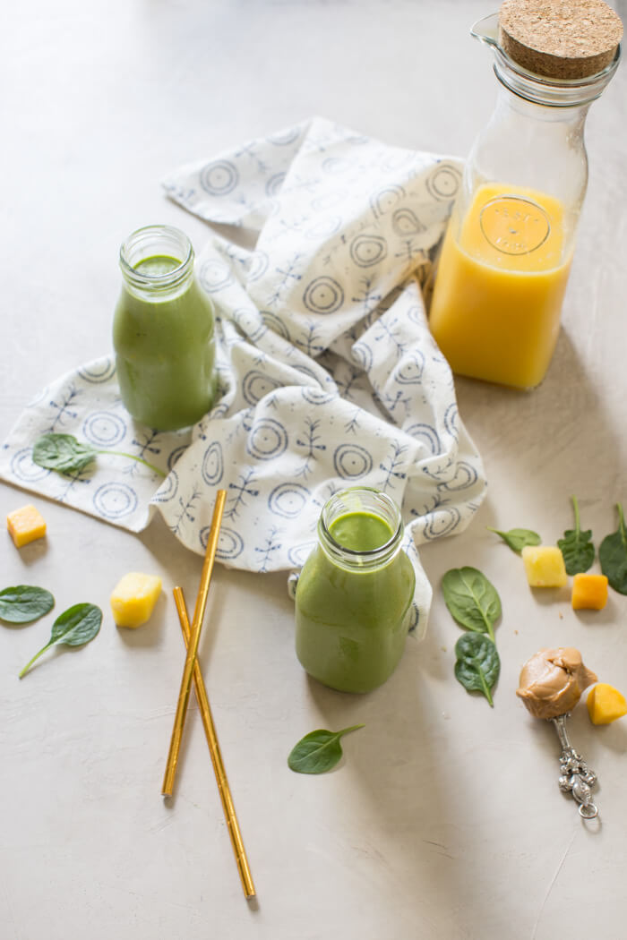 Broccoli, cauliflower, spinach, oh my! All the veg blended into this Green Power Smoothie and you can't even taste it thanks to OJ and peanut butter! This is a kid favorite!