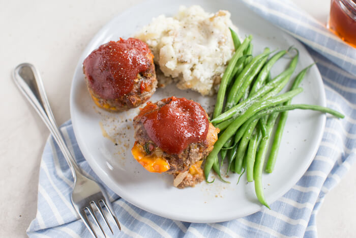 Cheesy Meatloaf Minis made in the muffin tin and full of hidden veggies. Freezer friendly, family friendly weeknight meal that's gluten free.